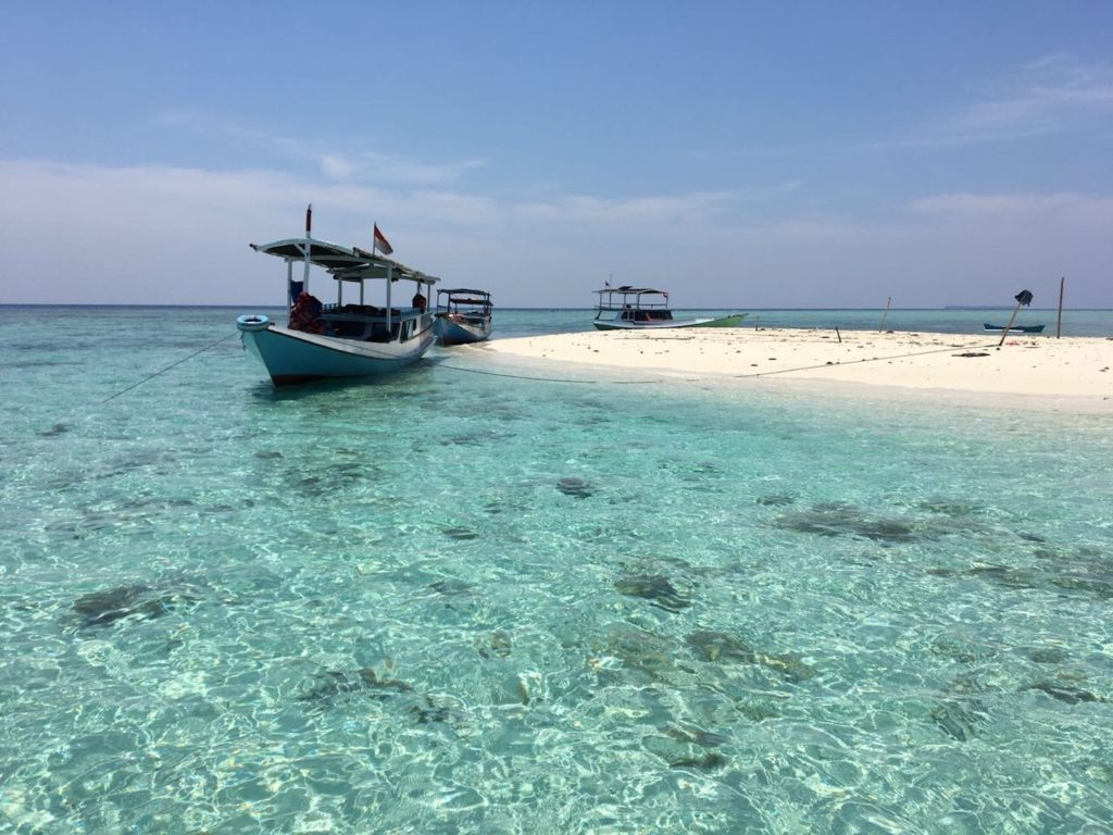 Boats on a beach. travel Indonesia in 2 weeks