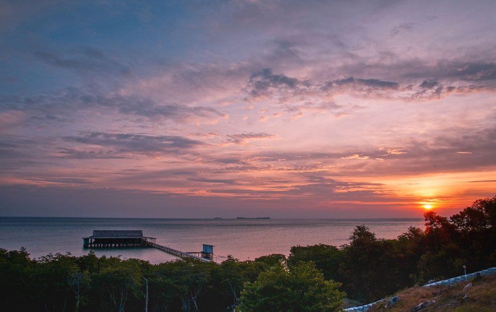 sunset over the ocean nearby Karimunjawa islands