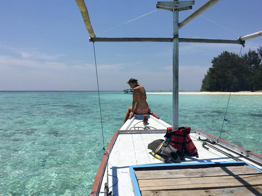a boat in blue water on  karimunjawa island