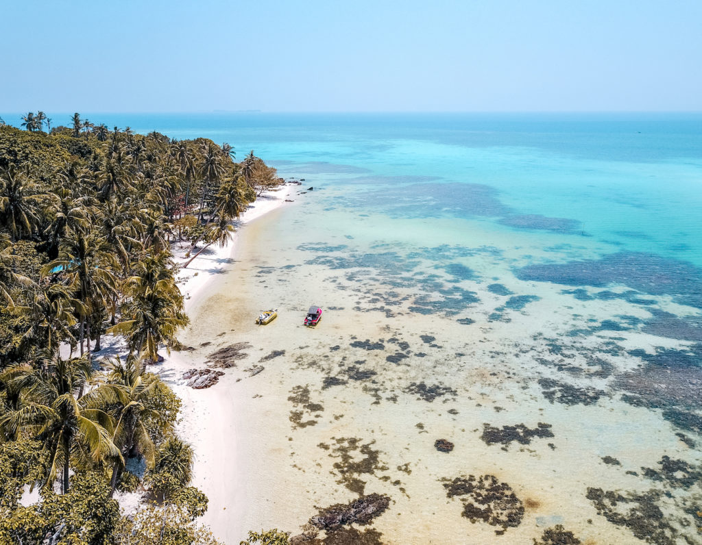 Aerial view on beach, jungle and ocean. explore Indonesia in 2 weeks Karimunjawa Islands