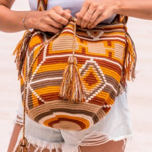 girl in white t-shirt holding Authentic Handmade Wayuu Bag