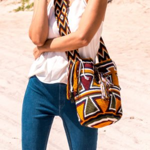 girl in blue jeans wearing Authentic Handmade Colombian Wayuu bag