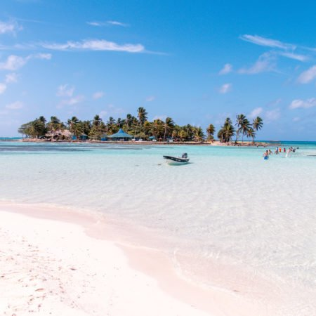 view on an San Andres Island covered by palm trees and surround by the Caribbean ocean which has to be part of your 2 weeks Colombia itinerary.
