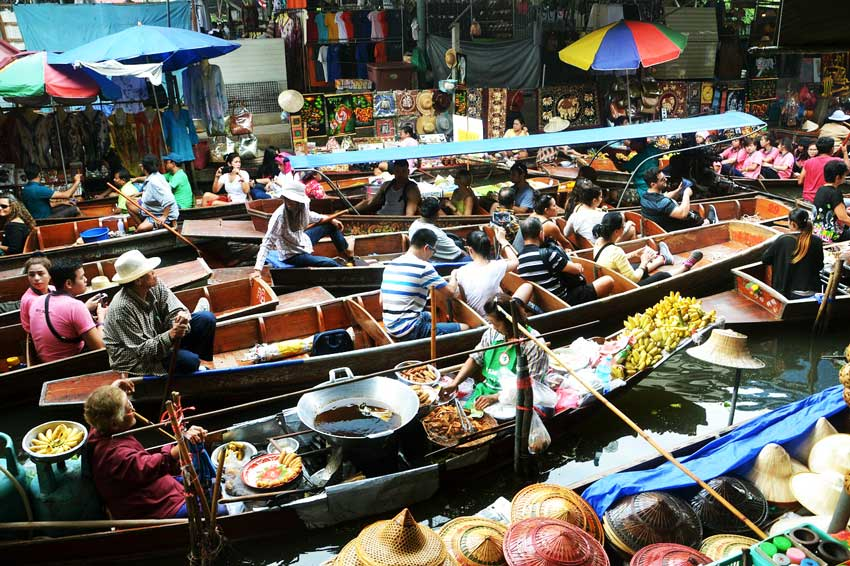 floating market with many boats and people near Bangkok