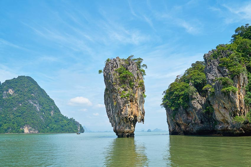 a big rock standing in the sea, James Bond Island #thailand#thailandtravel#thailandtraveltips#thailandthingstodo#bestof thailandbucketlists#experiencesinthailand