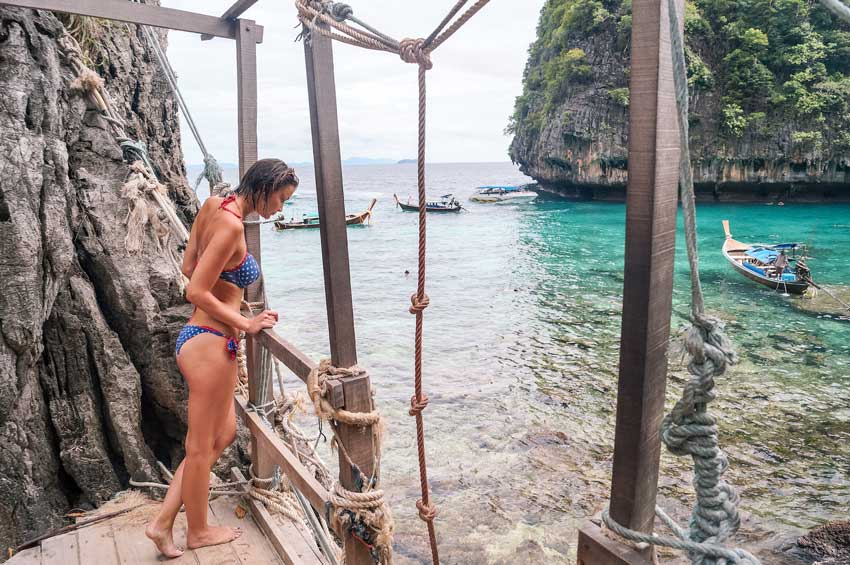 A girl looking down on turquoise waters near Krabi on an island hopping tour