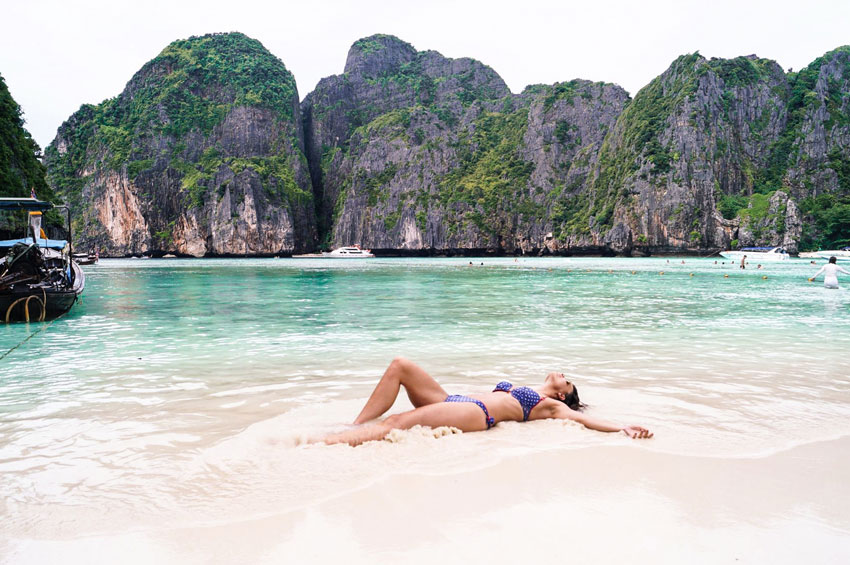 a girl enjoying maya bay beach one of the best beaches in Krabi