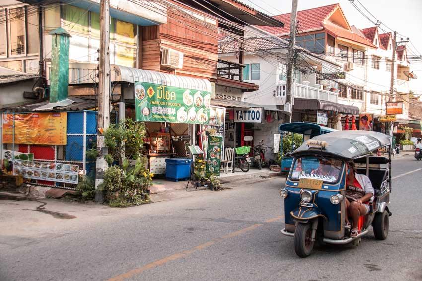 a small tuk tuk driving around in Chiang Mai,  #thailand#thailandtravel#thailandtraveltips#thailandthingstodo#bestof thailandbucketlists#experiencesinthailand