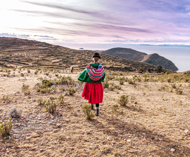 Woman dressed traditional Bolivian clothing walking