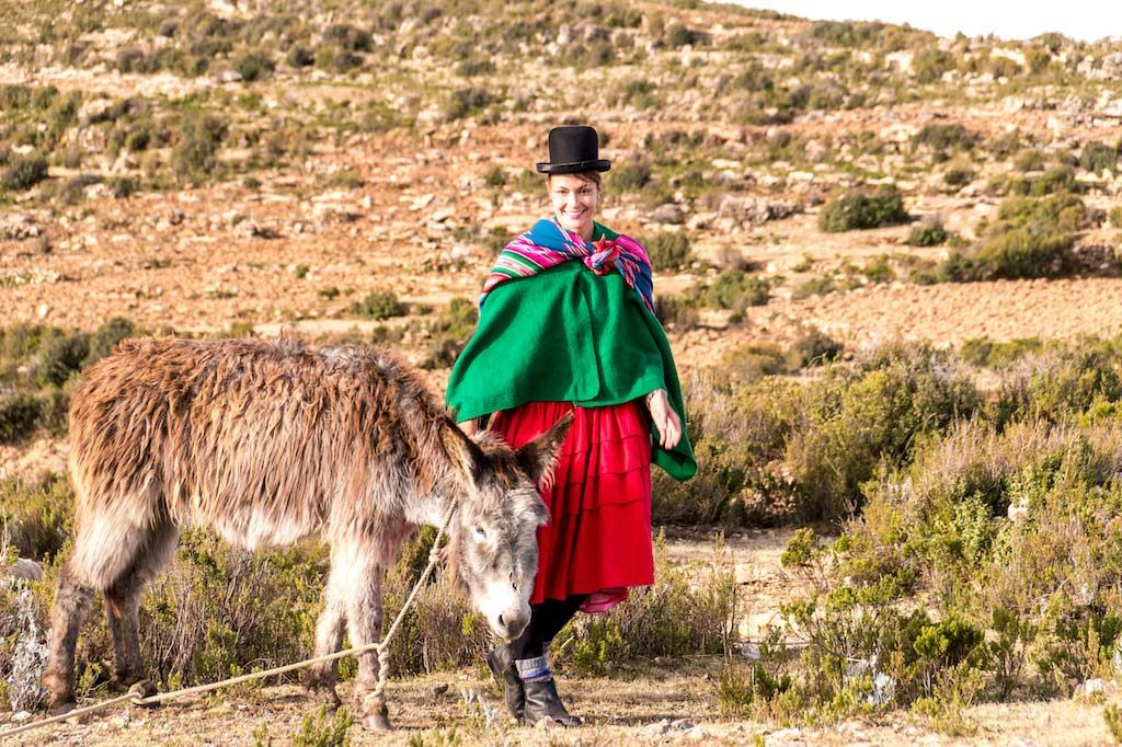 a girl with a donkey on Isla del Sol in Bolivia #Isladelsol#isladelsolbolivia#bolivia#boliviatravel#boliviaisladelsol#southamerica#southamericabackpacking#southamericabucketlist
