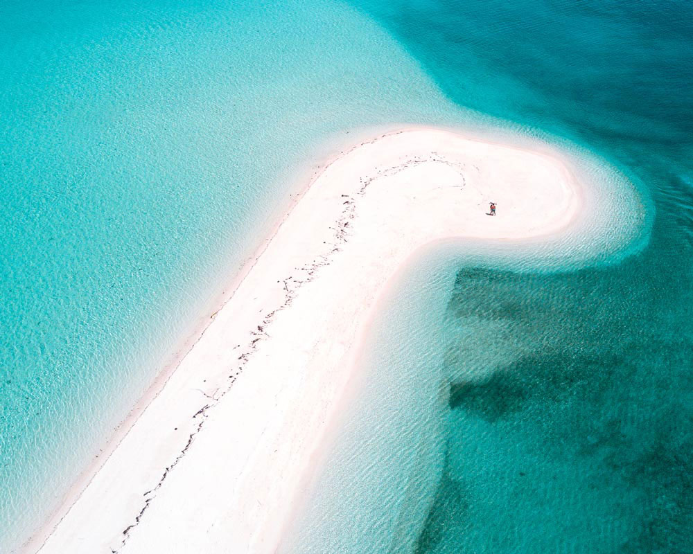 A drone shot of a beautiful island surrounded by blue water and white sand, Kalanggaman Island, Philippines #kalanggamanisland#kalanggamanislandphilippines#kalanggamanisland leyte#kalanggamanislandbeautiful#kalanggamanislandinthephilippines#philippines