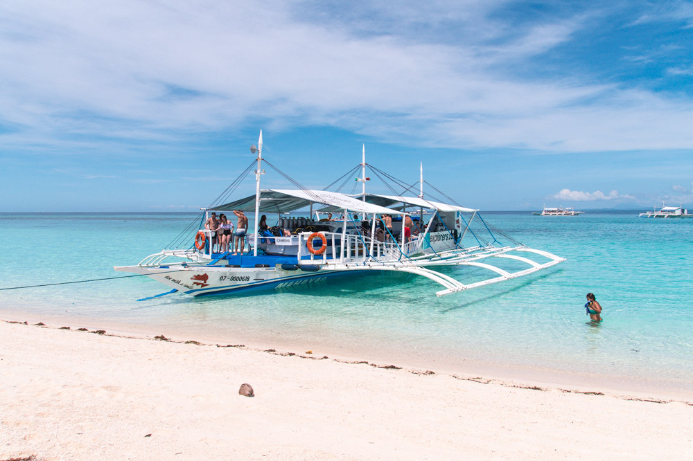 Typical Philippine boat on a beach on Kalanggaman island in the beautiful Philippines