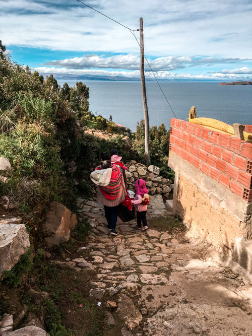 Woman and little walking down some stairs #Isladelsol#isladelsolbolivia#bolivia#boliviatravel#boliviaisladelsol#southamerica#southamericabackpacking#southamericabucketlist