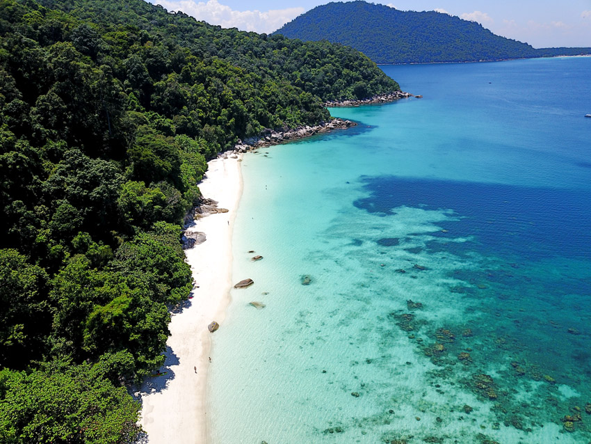Aerial view on a beach, jungle and the ocean. perhentian diving: Drone shot #perhentianislands#perhentianislandsmalaysia#perhentianislandsdiving#malaysia