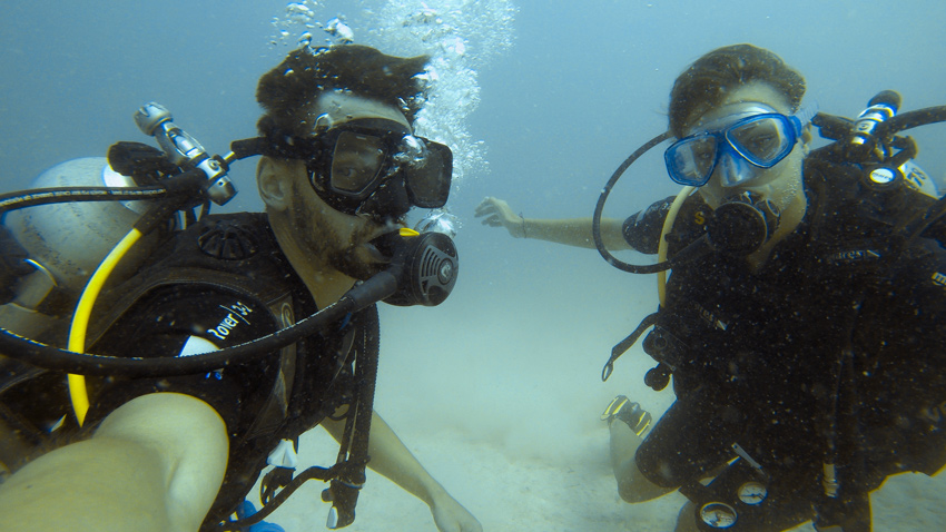 2 scuba divers underwater posing for the camera during a dive on Malapascua, Philippines