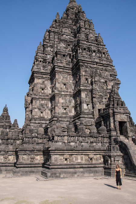 Girl in front of large hindu temple  explore Indonesia in 2 weeks