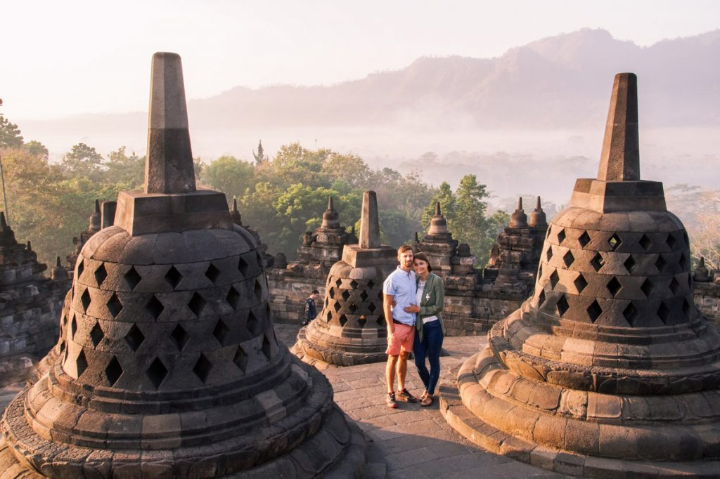 two weeks Indonesia itinerary Buddhist temple stupas and two persons.