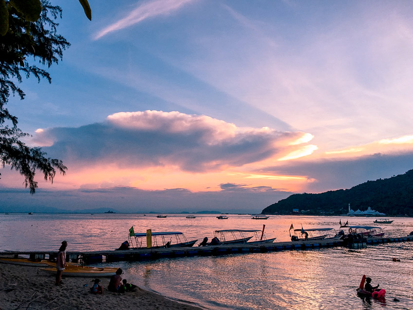 Boats, beach and people. sunset on Perhentian islands