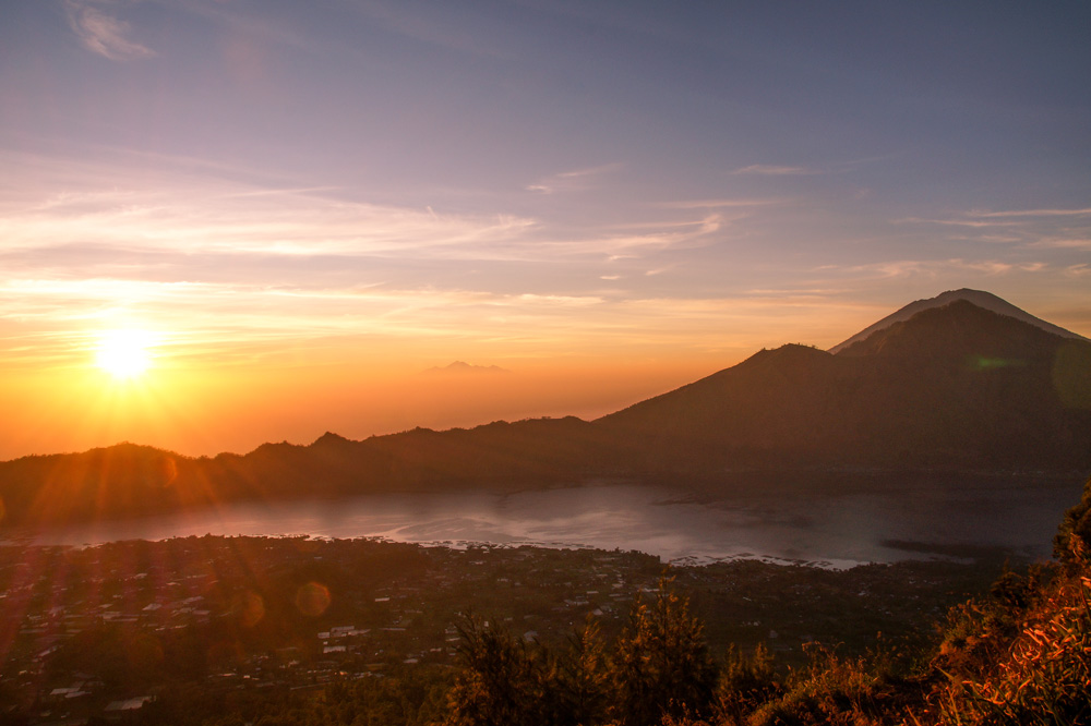 Sunrise over a lake and mountains. Indonesia itinerary 2 weeks