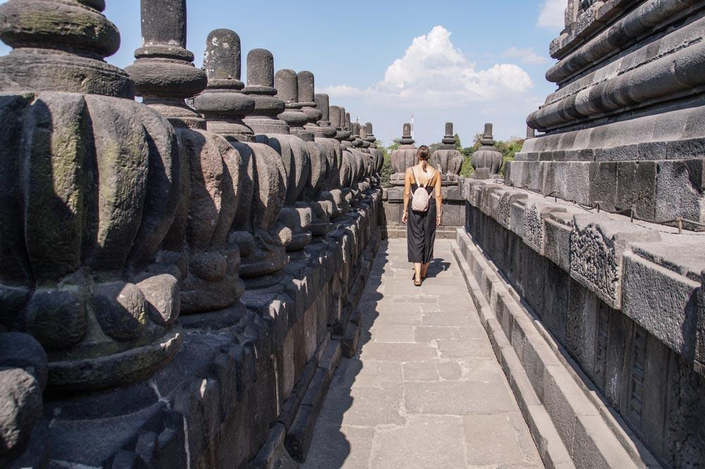 Girl walking inside a hindu temple