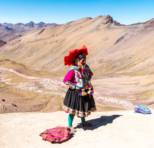 woman in traditional peruvian clothing posing for the camera
