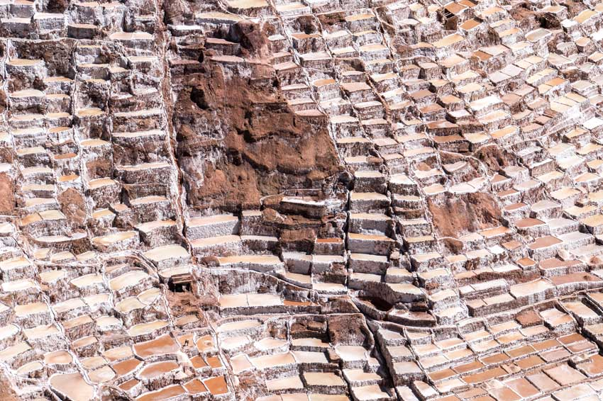 cascading natural pools filled with natural pink salt in Salinas de Maras