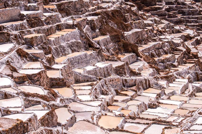 colourful steps of pink salt in Salinas de Maras