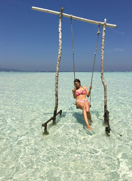 swinging around heavenly blue water on Karimunjawa