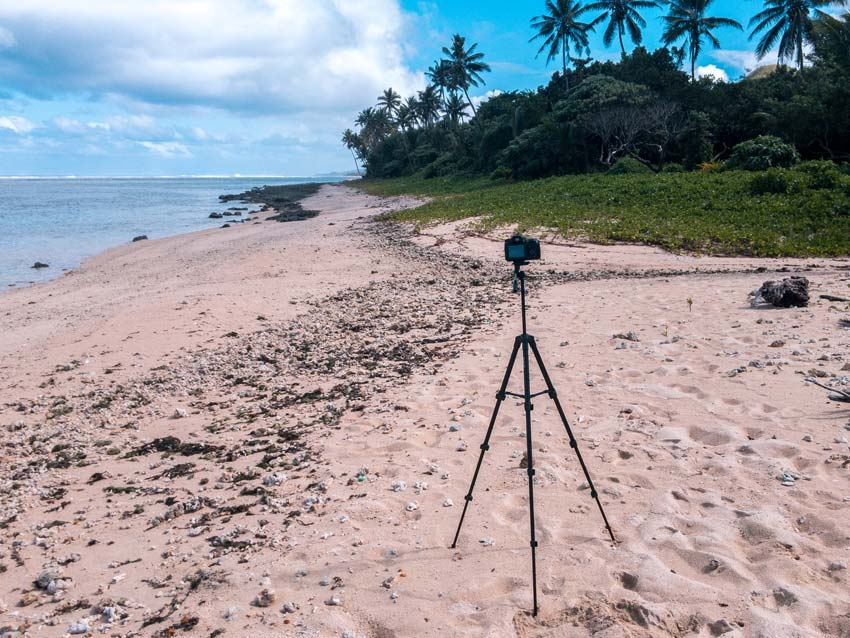 a camera mounted on a tripod on a beach in fiji