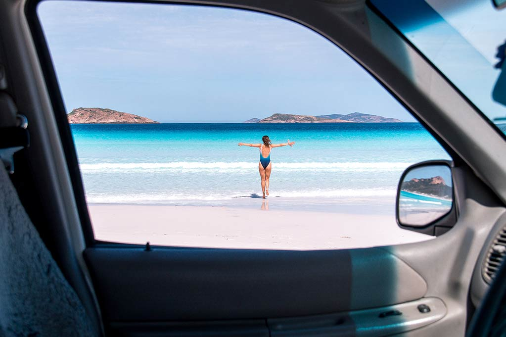 girl running on the white sand beach in Lucky bay, Australia, near Esperance in the Cape Le Grand National Park