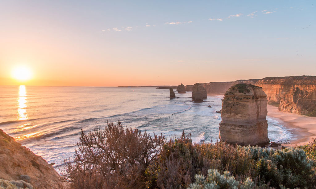 sunset photo at Twelve Apostles, pinky sky, rocks and ocean which is must see during Great ocean road itinerary in 2 days