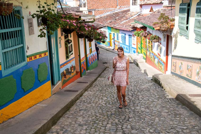 a lady walking up the calle de recuerdos in Guatape Colombia
