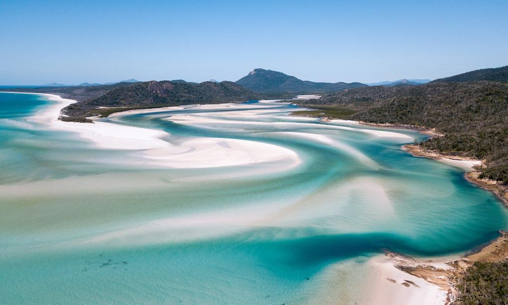 Whitsundays, one of the best known landmarks in Australia, turquoise blue water with white sand swirling around