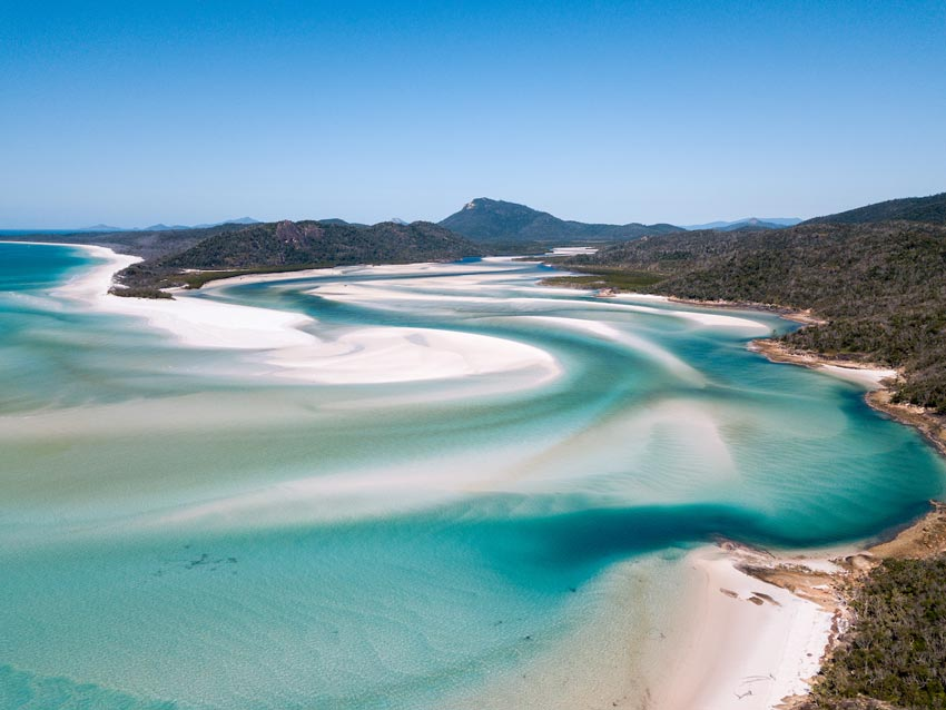view on hill inlet with turquoise waters, white sand and green trees on the whitsundays one of the famous landmarks in australia