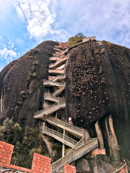 black mountain and zig-zag staircase to Piedra del Peñol