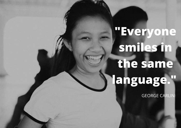 a picture showing a laughing girl and a smile quote