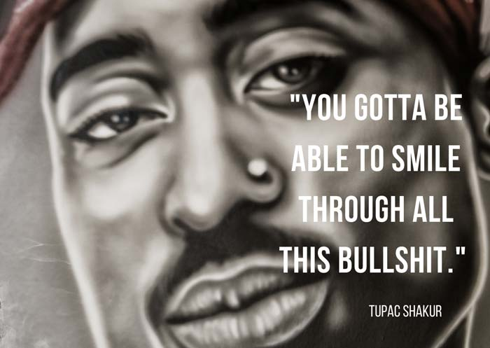 a graffiti showing tupac and a smile quote