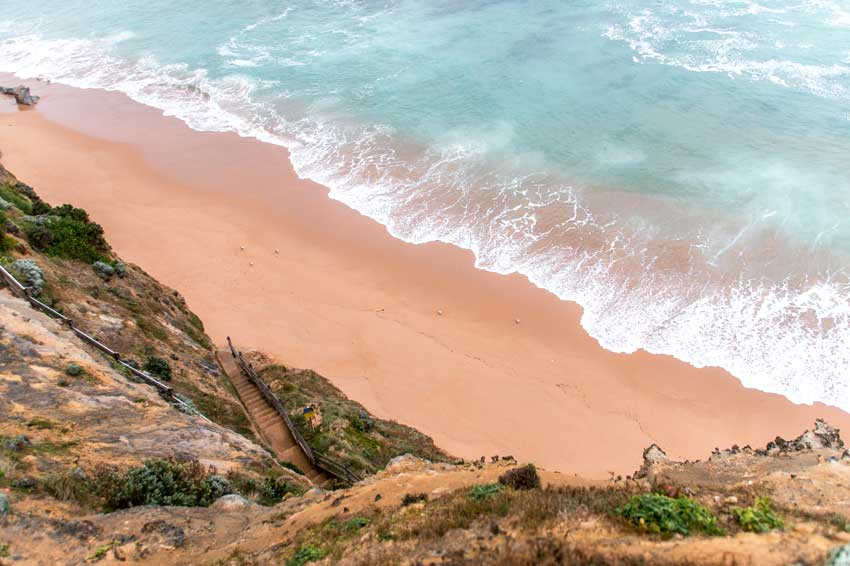 a view on the beach, sand and Gibson Steps on the Great Ocean Road