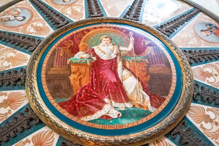 painted photo of Napoleon in red coat on the floor in  Museum de Napoleon