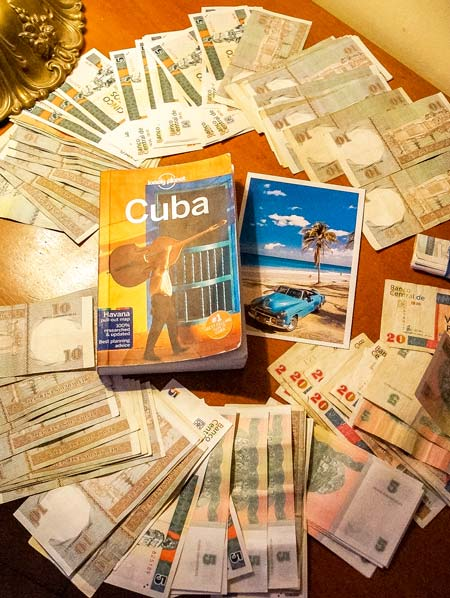 cuban tourist money in CUC and the lonely planet guide to Cuba