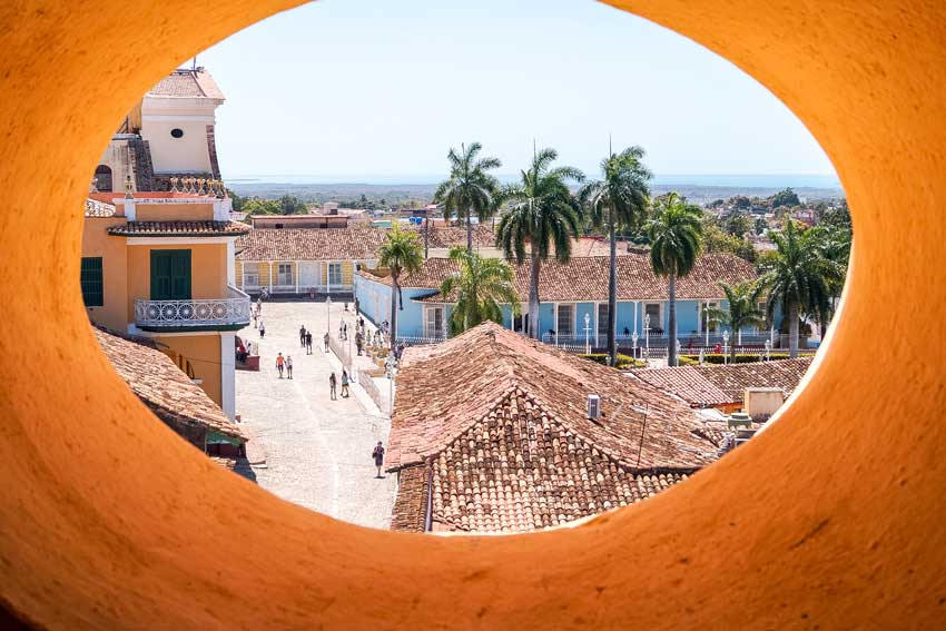 a view from bell tower on green palm trees and houses in Trinidad that you must see during your 10 days in Cuba