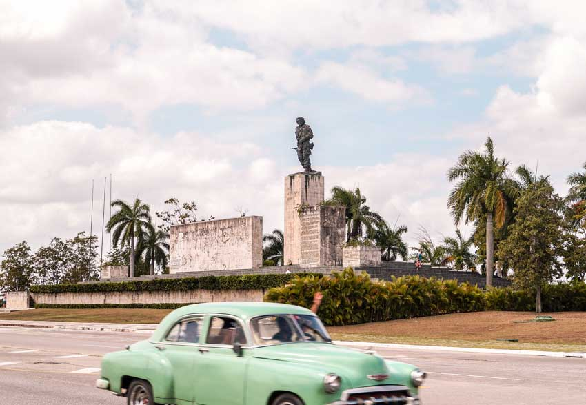 green car and The Che Guevara Mausoleum and Monument in Santa Clara, Cuba