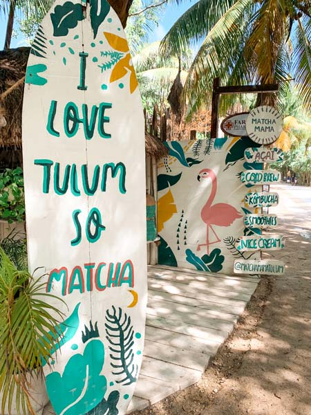 surfboard with I love you so Matcha, cute coffee bar and palm trees