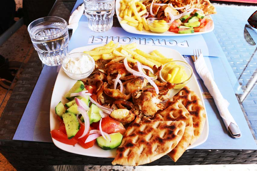 a photo of Gyros with fries, vegetables, tzatziki, one of the most traditional greek food