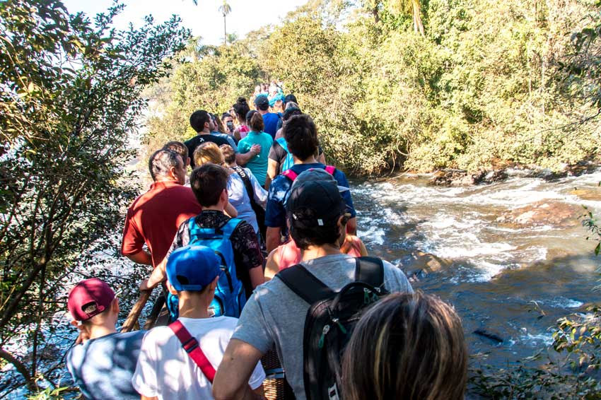 many people walking down the bridge in Iguazu