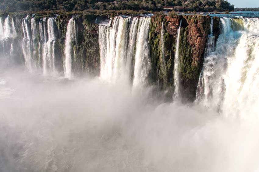 lot of water coming down from the waterfall in Iguazu falls in Argentina