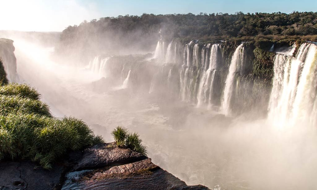 A view on cascading waterfall and green jungle in Iguazu falls, Argentina
