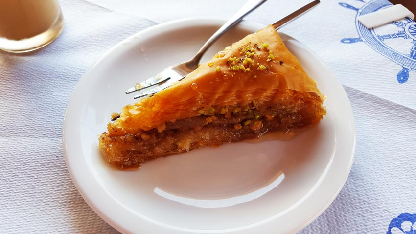 photo of Baklava one of the most traditional Greek meals, brown cake on the white plate
