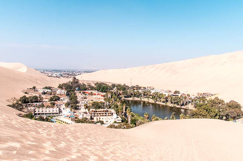 san dunes and the view on Huacachina Oasis in Peru