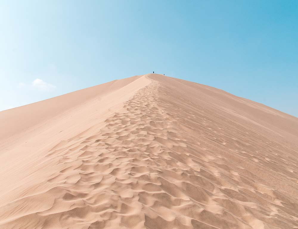 huge sand hill with foot steps